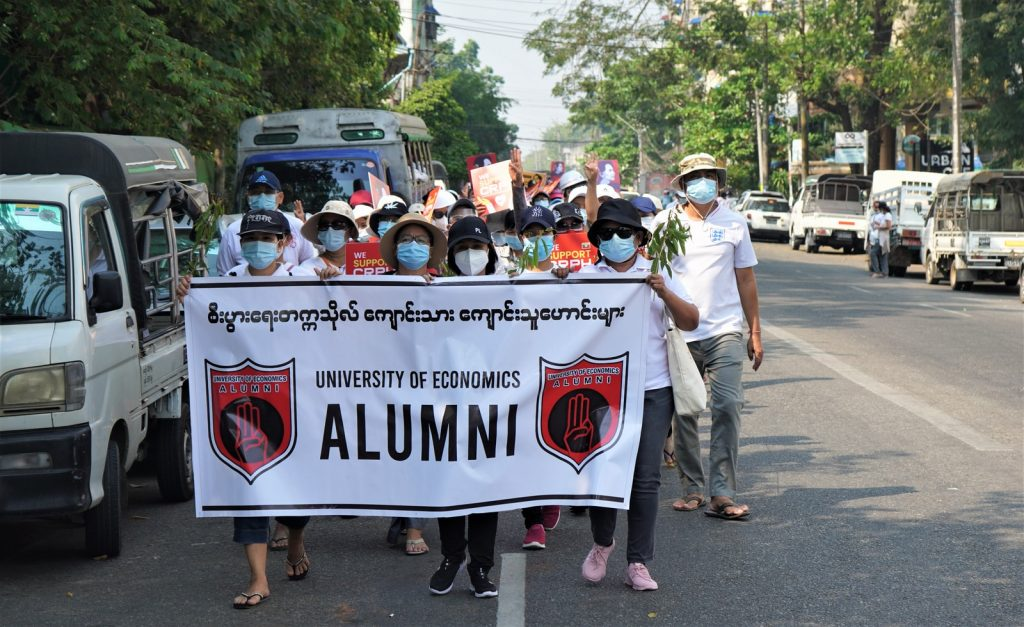 people holding white banner during daytime